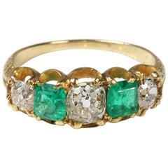 Circa 1890 18 Carat Gold Emerald Diamond Antique Victorian Engagement Ring