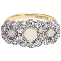 Early 20th Century Opal and Diamond Triple Daisy Ring
