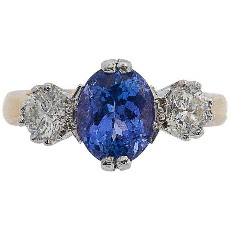 18 Carat Gold 2.33 Carat Tanzanite and 0.86 Carat Diamond Trilogy Ring For Sale