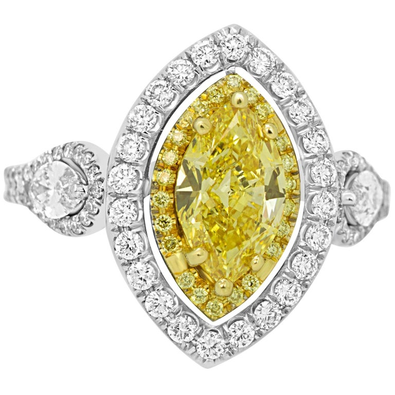 GIA Certified Fancy Intense Yellow Marquis Diamond in Double Halo Gold Ring