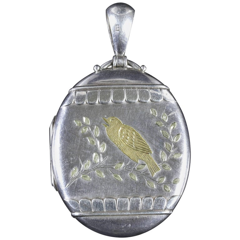 Antique Victorian Large Silver Locket with Gold Bird Dated 1876 For Sale