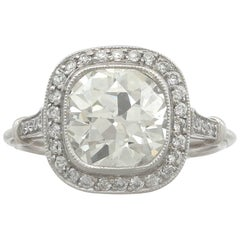 1900s 3.31 Carat Diamond and Platinum Halo Engagement Ring