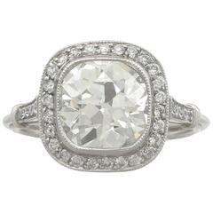 1900s 3.31 Carat Diamond and Platinum Halo Engagement Ring