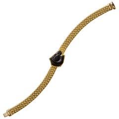 18 Karat Onyx and Gold Horse Bracelet