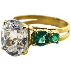 6.8 Carat White Zircon and Emerald 18Kt Yellow Gold Ring