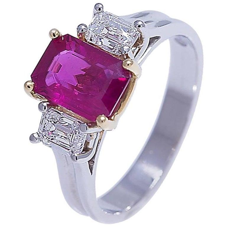 Elegant Platinum and 18 Karat Emerald Cut Ruby and Emerald Cut Diamonds Ring