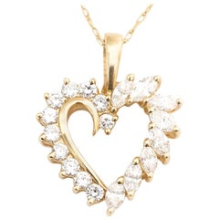 1950s Diamond and 14 karat Yellow Gold Heart Necklace