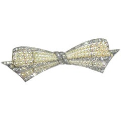 Exquisite Art Deco Natural Pearl Diamond Platinum Bow Pin