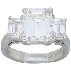 GIA Certified Emerald Cut Three-Stone Diamond Engagement Ring