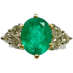 Emerald and Diamonds White and Yellow Gold