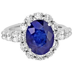Tanzanite Oval Diamond Halo Gold Bridal Ring