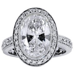 H & H 3.18 Carat Oval Diamond and Pave Engagement Ring