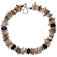 Necklace of Chunky Slices of Pink Peruvian Opal Accented with Black Onyx Rondels