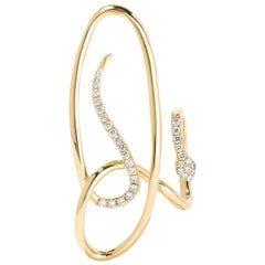 Yvonne Leon Contemporary Earring Snake in 18 Karat Yellow Gold and Diamonds
