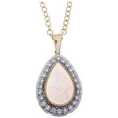 18 Carat Gold 1.12 Carat Opal and Diamond Drop Pendant
