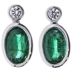 18 Carat White Gold 0.76 Carat Emerald and Diamond Earrings