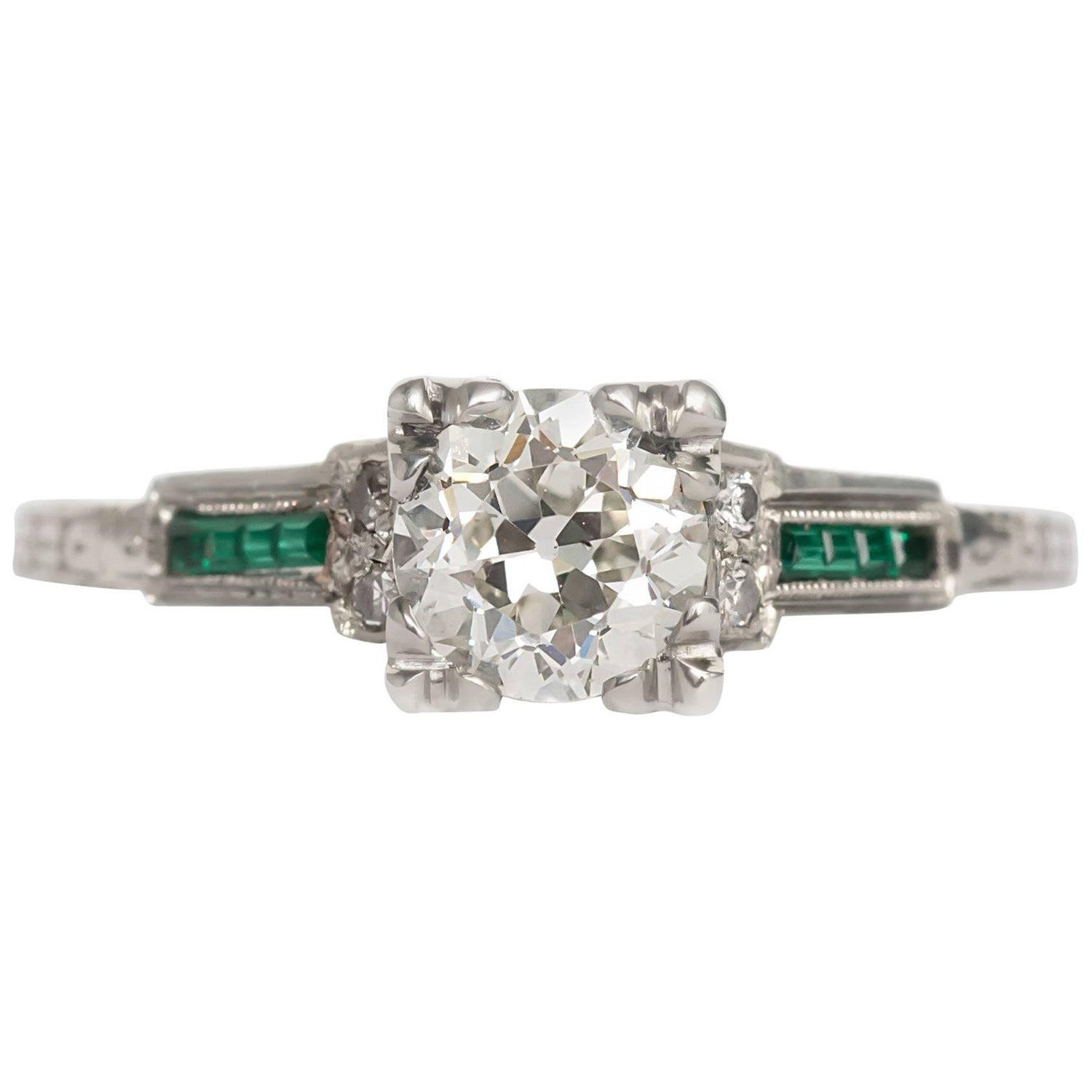 1930 white gold art deco circular brilliant diamond and emerald