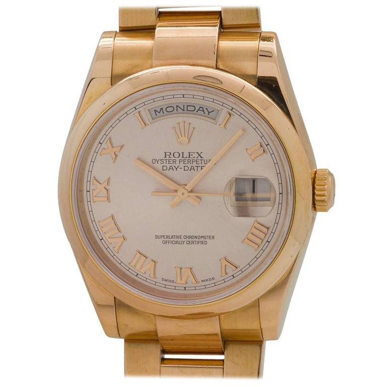 Rolex Yellow Gold Oyster President Roman Rose Dial Wristwatch, circa 2000 For Sale