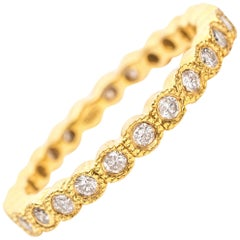 1990s Diamond and 14 Karat Yellow Gold Eternity Band Ring