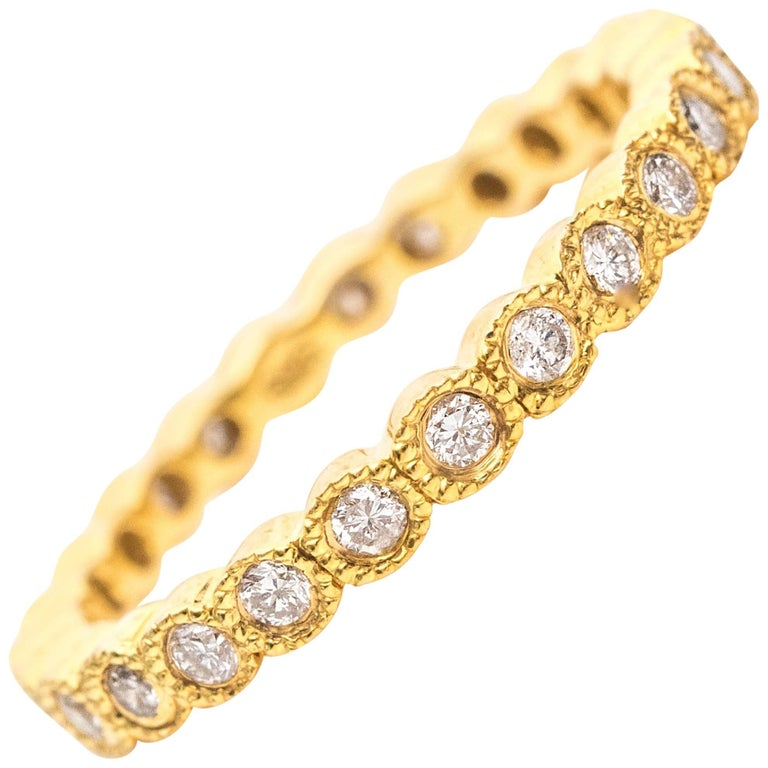1990s Diamond and 14 Karat Yellow Gold Eternity Band Ring For Sale