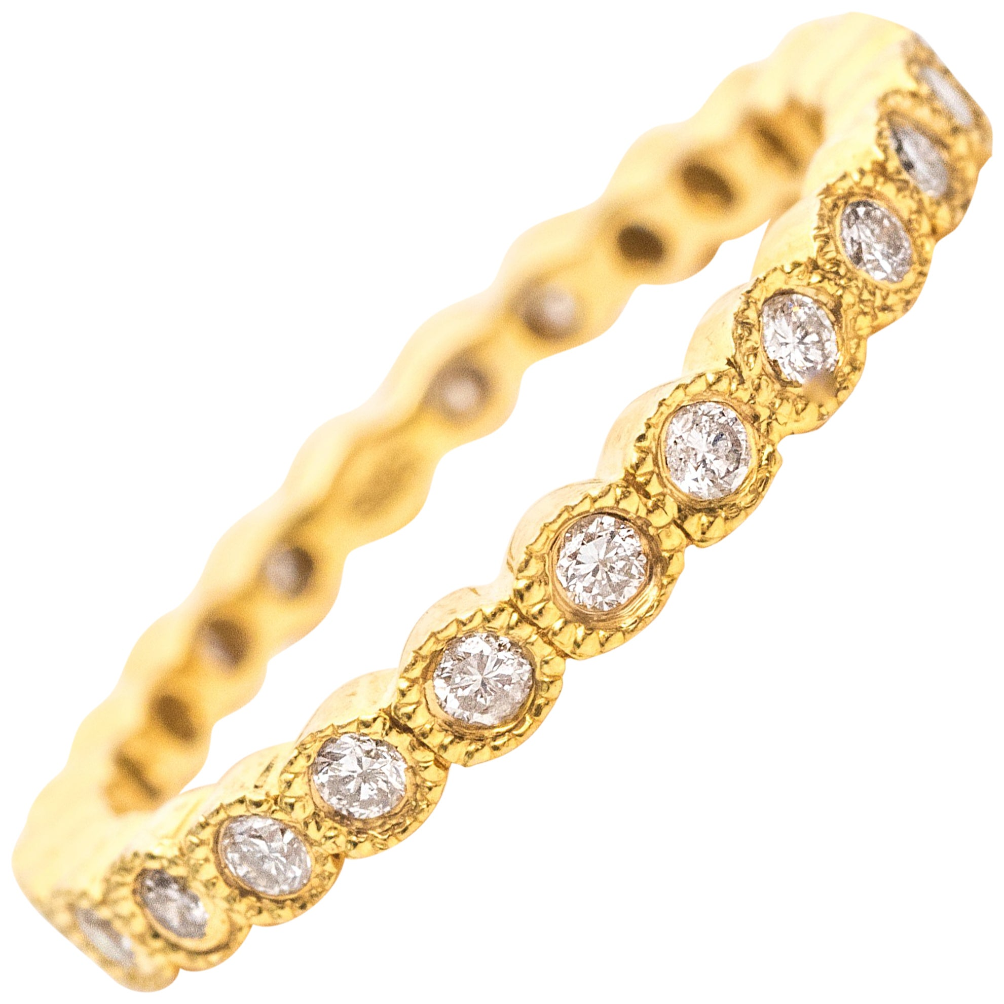 1990s Diamond and 14 Karat Yellow Gold Eternity Band Ring