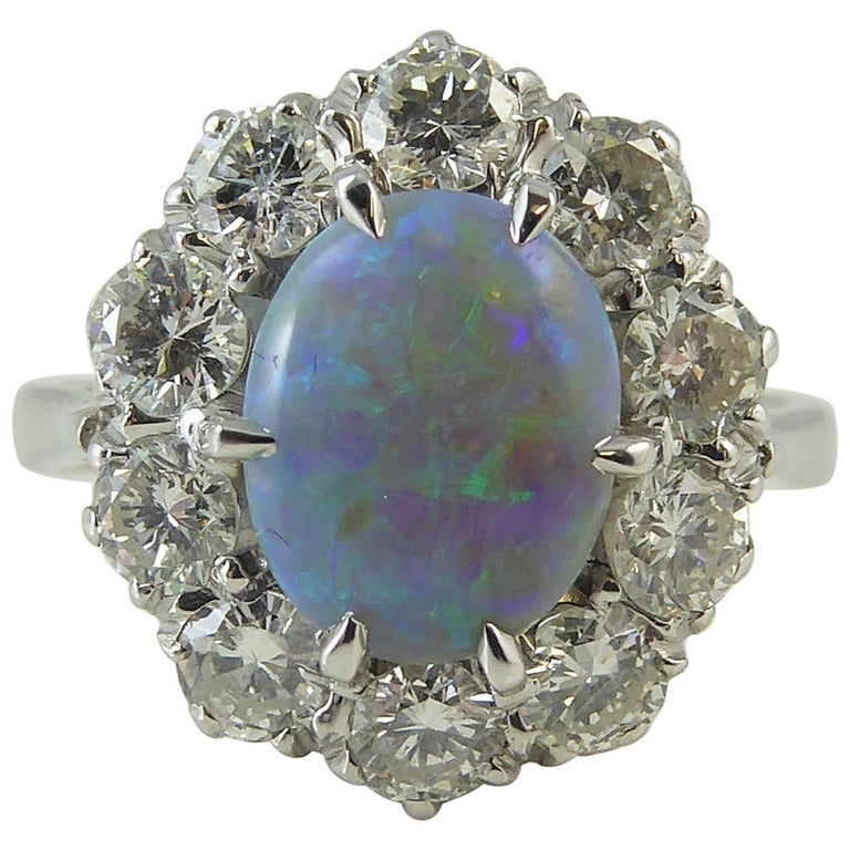 Pre-Owned Opal and Diamond Cluster Ring For Sale