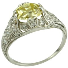 1.61 Carat Natural Fancy Yellow Old Mine Cut Diamond and Platinum Ring