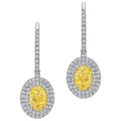 Timeless GIA Certified 4.07 Carat Light Yellow Diamond White Gold Earrings