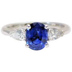 Ceylon Sapphire and Pear-Shaped Trillion-Cut Diamond Diner Ring