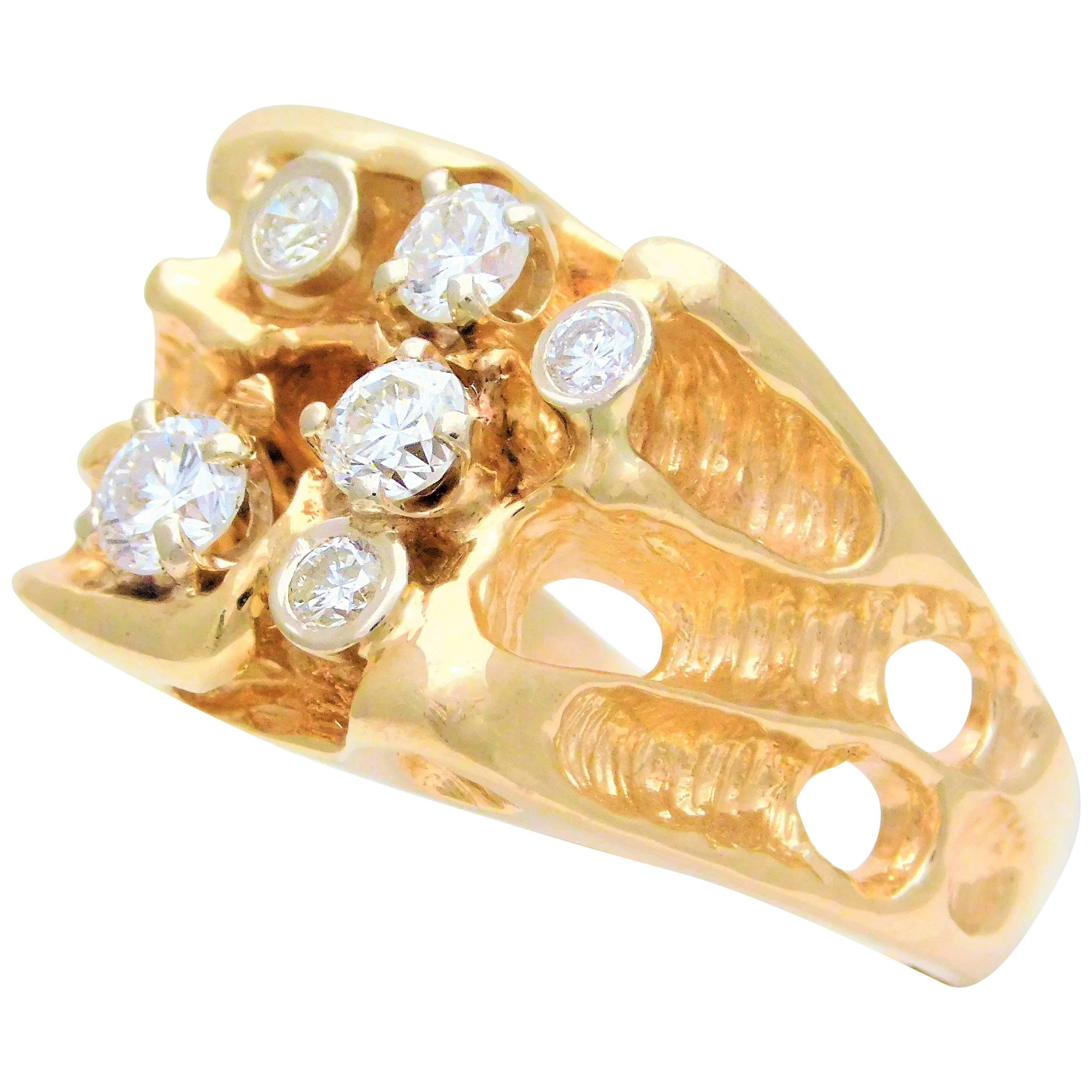 gents 14 karat yellow gold ring with diamonds