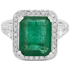 GIA Certified Minor 6.30 Carat Emerald Diamond Halo Gold Cocktail Ring
