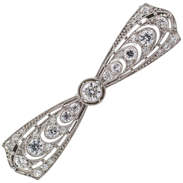 T B Starr Edwardian Diamond Platinum Bow Brooch For Sale