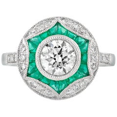 Geometric Circular Emerald Diamond Engagement Ring