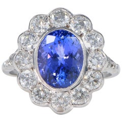 3.60 Carat Tanzanite 2.60 Carat Diamonds Halo Ring