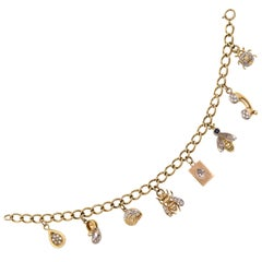 Adorable 14 Karat Yellow Gold and Diamond Charm Bracelet