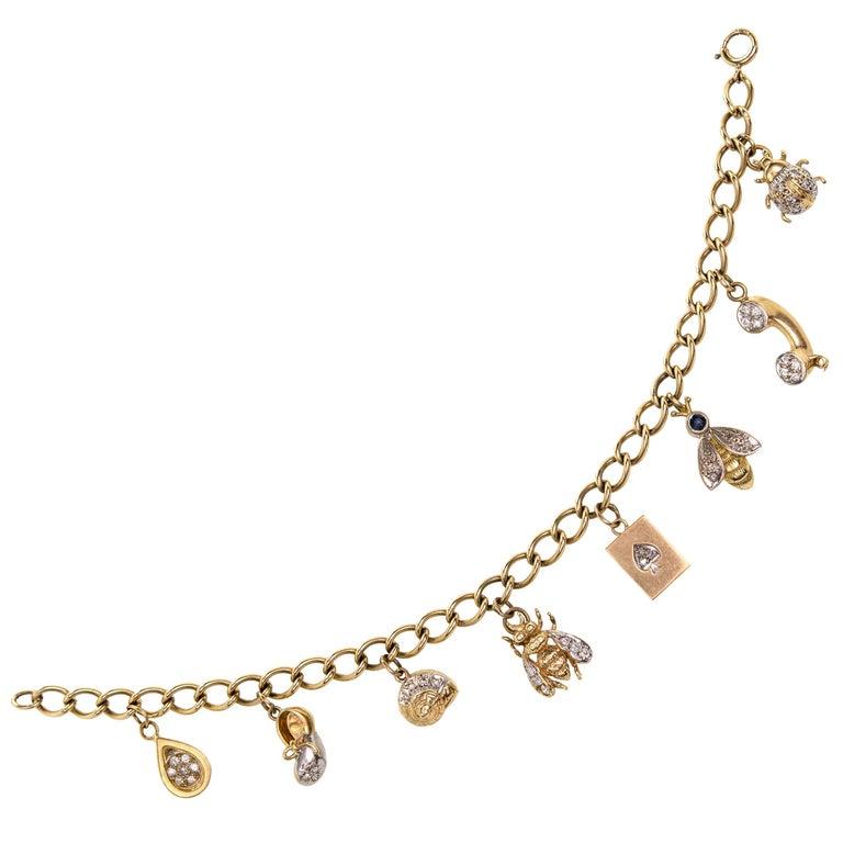 Adorable 14 Karat Yellow Gold and Diamond Charm Bracelet