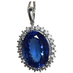 11.39 Carat Tanzanite and Diamond Pendant 18 Karat Gold Cluster Halo Necklace