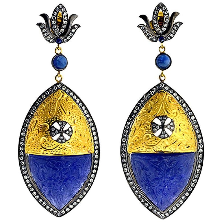 Carved Tanzanite Earring in Gold and Silver with Diamonds