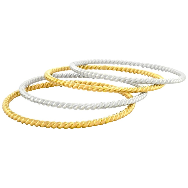 Bucherer set of Four Cable Twist Gold Bangles