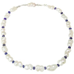 Iridescent Peanut Pearl and Tanzanite Rondel Necklace