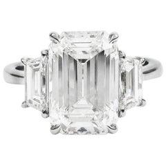 GIA Certified 5.21 Carat Total Emerald Cut Three-Stone Diamond Platinum Ring