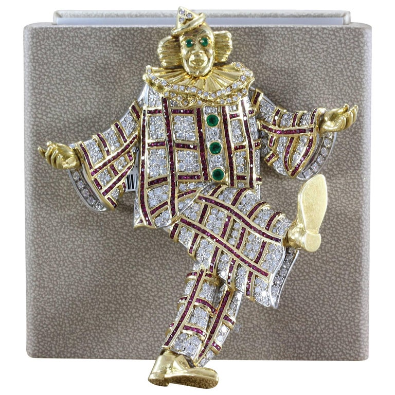 We aren't clowning around here! This brooch features approximately 16 carats of VS quality full cut diamonds. 4.50 carats of vivid red rubies, set in 18K yellow gold and platinum, run up down and across the clowns gem studded suit. Half a carat of