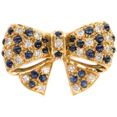 1950s Vintage 18 Karat Yellow Gold E.W&CO Brooch with Diamonds and Sapphires