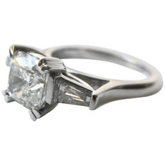GIA certified 1.51 Carat E-VS2 Cushion Cut and Tapered Baguette Diamond Ring