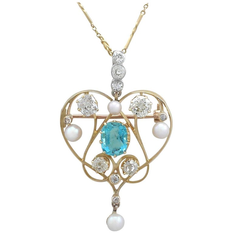 1890s Diamond and Aquamarine, Pearl and 18 Karat Yellow Gold Pendant / Brooch