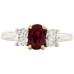 Vintage 1.08 Carat Oval Ruby and Diamond Three-Stone Ring
