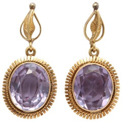 18 Karat Purple Sapphire Earrings