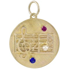 Gold Gemset Musical Note Charm