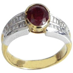 Oval Shape Ruby 1.93 and Baguette Cut Diamonds 0.82 Ring, circa 1920