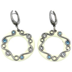 Silver Round Earrings with White Enamel White Topaz and Blue Topaz